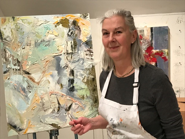 Susan Bazett with one of her paintings that she created for Factory Mark