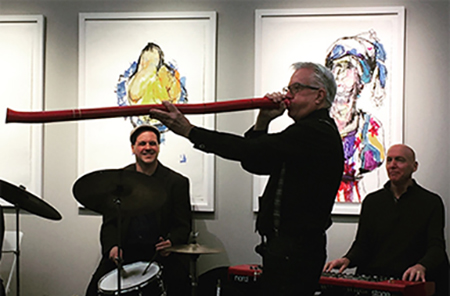 President, Bob Fields having fun with the band at the grand opening of Factory Mark Gallery